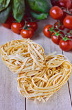 Italian Ingredients, Tagliatelle pasta Royalty Free Stock Photos