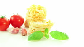 Italian ingredients, tomato garlic pasta and basil isolated on white background stock video footage
