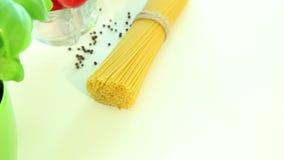 Italian ingredients, tomato garlic pasta spaghetti pepper and basil stock video