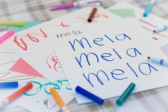 Italian; Kids Writing Name of the Fruits for Practice Royalty Free Stock Photography