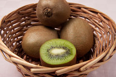 Kiwi. Italian kiwi in little basket Royalty Free Stock Photo