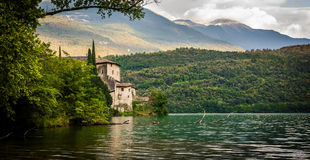 Italian lake house. Beautiful scene beside a lake in Italy with the mountains in the background stock image