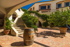 Italian landscape. Elegant Italian landscape located in a shopping center of Porto Cervo. Sunny, grren, garden, barrel, stairs Stock Images