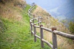 Italian landscape, hills and wooden handrails. Autumn nature concept. Italian landscape, hills and wooden handrails stock photo