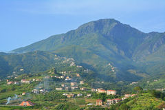 Italian landscape. A photo of a village  in front of a mountain in italy Stock Photos
