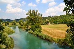 Italian landscape with river. Rural Italian landscape with river in summer royalty free stock photo