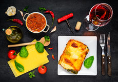 Italian Lasagna Pasta with Wine and Cooking Ingredients royalty free stock image
