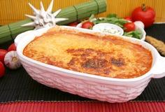 Italian Lasagne. A fresh italian lasagne with cheese and tomato sauce Stock Photo