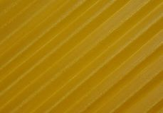 Italian lasagne. Background italian yellow lasagna close up with visible texture Royalty Free Stock Photos