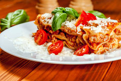 Italian lasagne with tomato Stock Photos