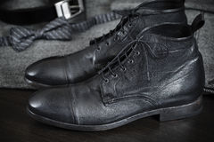 Italian Leather Boots. Premium leather hand-made shoes, selective focus on nearest part Royalty Free Stock Photography