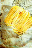Italian linguine or tagliatelli pasta Royalty Free Stock Image