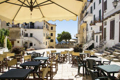Italian little village. Outdoor bar in an italian little village of the south close to the sea Royalty Free Stock Image