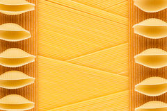 Italian long kinds spaghetti top view with copy space as decorative pasta background. Royalty Free Stock Images