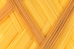 Italian long spaghetti top view abstract background of different colors. Royalty Free Stock Photography