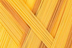 Italian long spaghetti top view abstract background of different colors. Royalty Free Stock Image
