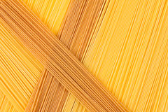 Italian long spaghetti top view abstract background of different colors. Stock Images