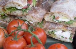 Italian lunch. Typical Italian lunch of ciabatta bread with mozzarella, basil and tomato stock photos