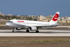 Italian A320. Luqa, Malta August 23, 2005: Eurofly Airbus A320-214 [I-EEZH] taking off runway 32 Royalty Free Stock Image