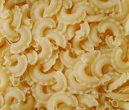 Italian  macaroni. The background of italian raw pasta closeup Royalty Free Stock Images