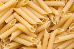 Italian macaroni pasta full background. Stock Photos