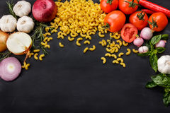 Italian macaroni with sauces ingredients Royalty Free Stock Images