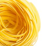 Italian macaroni tagliatelle nest isolated close-up. Top view royalty free stock images