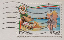 Italian mail stamp about folk masks from Sardinia. CAGLIARI, SARDINIA,ITALY - CIRCA JANUARY 2014: A stamp printed in Italy reading Sardegna (meaning Sardinia) Royalty Free Stock Photos
