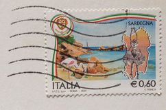 Italian mail stamp about folk masks from Sardinia. CAGLIARI, SARDINIA,ITALY - CIRCA JANUARY 2014: A stamp printed in Italy reading Sardegna (meaning Sardinia) Royalty Free Stock Photography