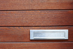 Italian mailslot. Italian aluminum mailslot on dark wood background royalty free stock image