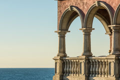 Italian mansion with columns as beach house with view on ocean Royalty Free Stock Image