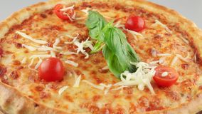 Italian margarita pizza with basil and mozzarella stock video footage