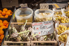 Italian market stall with artichokes  Royalty Free Stock Image