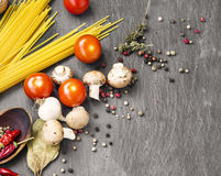 Italian meal ingredients with pasta,spices,tomatoes and mushroom Royalty Free Stock Image