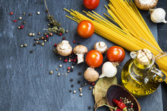 Italian meal ingredients with pasta,spices,tomatoes,olive oil an Royalty Free Stock Photos