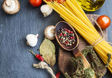 Italian meal ingredients with pasta,spices,tomatoes,olive oil an Stock Photo