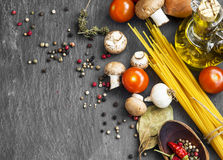 Italian meal ingredients with pasta,spices,tomatoes,olive oil an Stock Photography