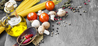 Italian meal ingredients with pasta,spices,tomatoes,olive oil an Stock Images
