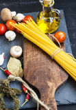 Italian meal ingredients with pasta,spices,tomatoes,olive oil on Stock Photos