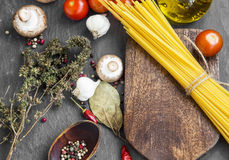 Italian meal ingredients with pasta,spices,tomatoes,olive oil on Royalty Free Stock Photography