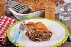 Part of lasagna with meat on a plate stock photos