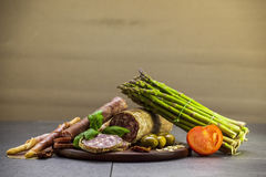 Italian meat food composition with fresh vegetables Stock Photos