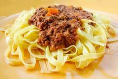 Italian meat sauce pasta on the table Stock Photography