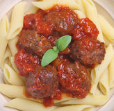 Italian Meatballs and Pasta. Beef meatballs in tomato sauce with rigatoni pasta Royalty Free Stock Photo