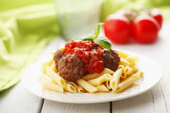 Italian meatballs with penne pasta in tomato sauce Royalty Free Stock Image