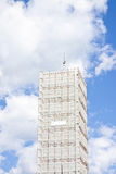 Italian medieval steeple covered by metal scaffolding for restor Royalty Free Stock Images