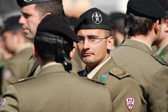 Italian military men in grey uniform. Roma, IT - 10 March 2011, Piazza Venezia, Italian military man in a uniform standing in the crowd and looking at the camera Stock Photos