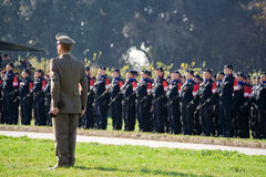 Italian military officer standing ahead of troops. Italian President Napolitano celebrates the return of Italian troops from Iraq. Royal Palace of Caserta Stock Images