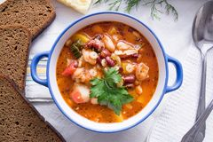 Italian Minestrone Soup in the plate top view stock photos