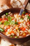 Italian minestrone soup in a bowl macro. Vertical Stock Photography